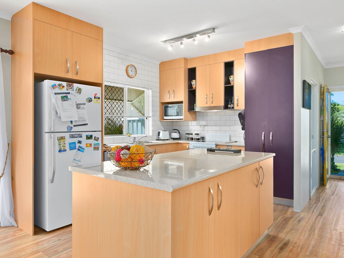 kitchen floors and cabinets property at 113 benjamina mount qld 4868